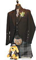 Designer jacket and waistcoat with black buttons. With grey Highlander Kilt, black shirt and charcoal cravat